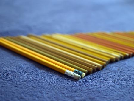 Colour pencils. Color pencils on a purple plaid. Yellow pencils