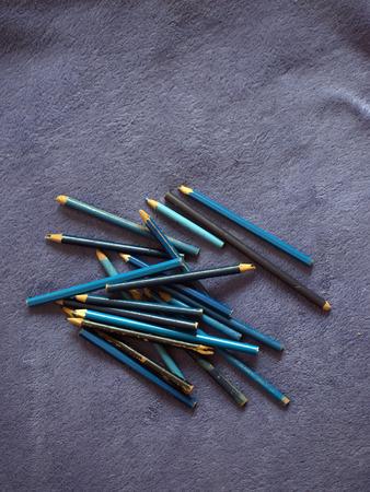 Colour pencils. Color pencils on a purple plaid. blue pencils 写真素材