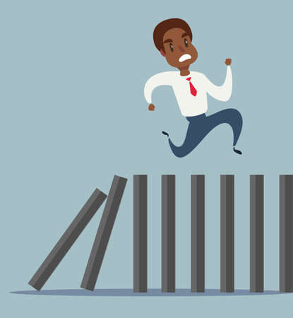 Business concept of a black african american businessman running on top of domino effect