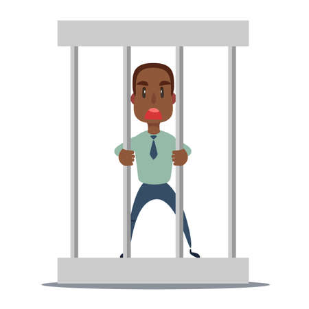 Sad businessman in office suit in prison behind the bars with metal ball chained to his leg. Financial crime concept.