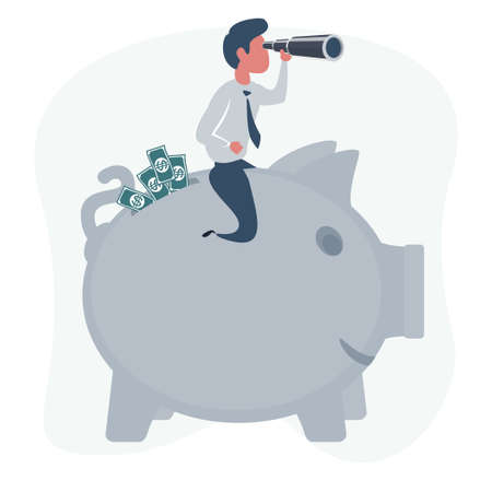 An investor is looking for where to invest money sitting on a piggy bank full of money. Investment concept.
