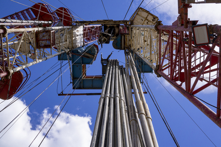 Oil and Gas Drilling Rig. Oil drilling rig operation on the oil platform in oil and gas industry. Stock Photo