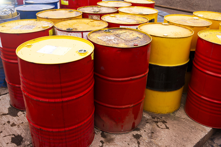colored metal barrels. Blue oil drums containing fuel for transportation Stock Photo