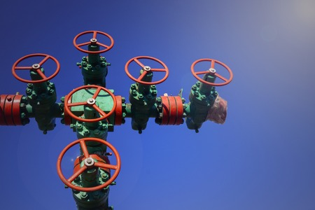 Oil and gas processing plant with pipe line valves. Oil pipeline valves in the oil and gas industry. Valve plug an oil pipeline in the field on a sunny summer day