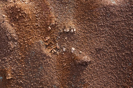 Red earth or soil background. Tropical laterite soil  background of red clay. Dry Orange surface, Picture of natural disaster. Drought land Caused by global warming and deforestation. Stock Photo
