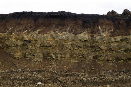 Soil cut-sandstone, stones, sand structure and layers