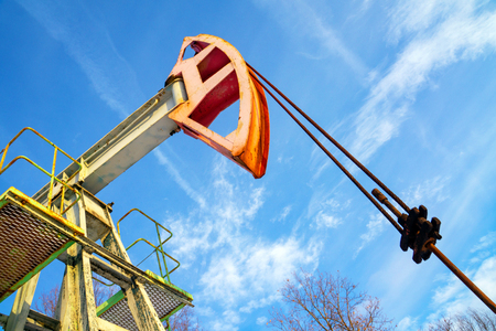 Oil and gas industry. Work of oil pump jack on a oil field in desert.