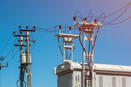 high voltage tower power line for electricity on blue sky with cloudy background