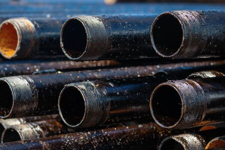 Close up drill pipe thread with pipe dope grease lay down on rig floor at oil and gas on shore location