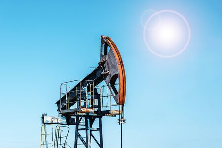 Oil pumpjack, industrial equipment. Rocking machines for power generation. Extraction of oil. Oil well industry.