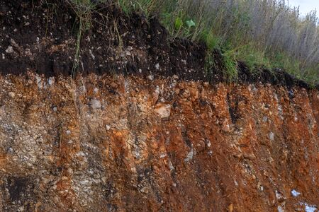 The curb erosion from storms. To indicate the layers of soil and rock. Nature cross section soil underground with green grass, cutaway earth ground terrain surface Stock Photo