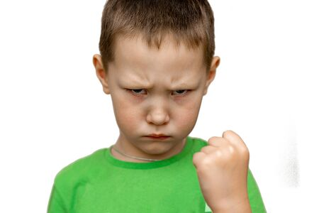 little angry boy threatening shows fist. relationship problems of children and parents. child psychology concept Standard-Bild - 133608069