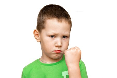 little angry boy threatening shows fist. relationship problems of children and parents. child psychology concept Standard-Bild - 133608072