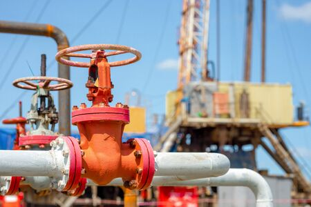 Close-up of the valve plug an oil pipeline in the field on a sunny summer day. Offshore the Industry oil and gas production petroleum pipeline Stock Photo