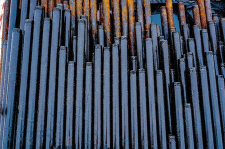 Construction of Oil and Gas Pipeline, horizontal directional drilling. Drilling of oil and gas wells. In the foreground, a threaded joint of pipes