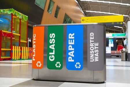 Recycling of garbage separation and recycling concept. Colorful bins for different garbage with sorted garbage icons