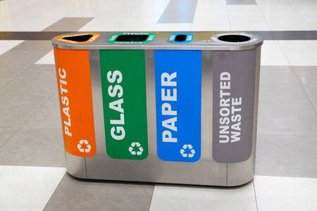 Recycling of garbage separation and recycling concept. Colorful bins for different garbage with sorted garbage icons.