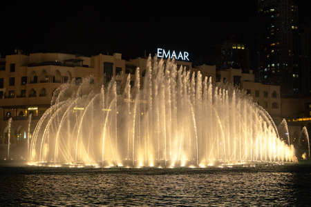 United Arab Emirates, 3.MARCH.2020: famous musical fountain in Dubai with skyscrapers in the background on a beautiful summer evening. Dancing Fountain the famous and largest fountains in the world