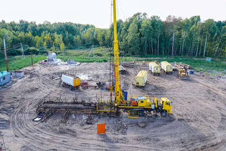 Special equipment for drilling an oil well in an oil field. Workover rig working on a previously drilled well trying to restore production through repairIn a row are oil-producing wells