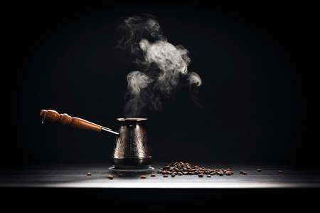 bronze bowl: Coffee Pot On Dark Background