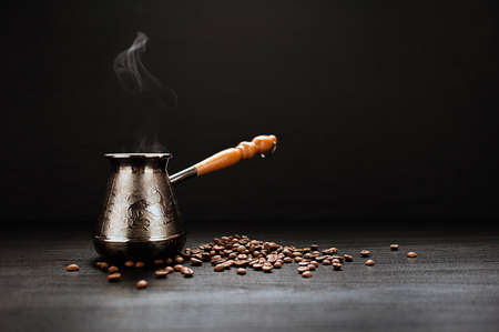 bronze bowl: Coffee Pot And Coffee Beans On Dark Background