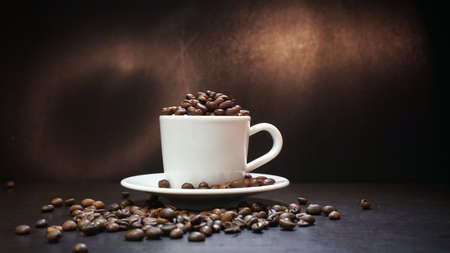 Cup With Coffee Beans Isolated on Black Background. Stock Photo