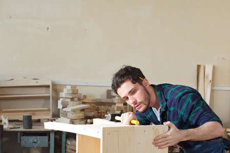 Handsome Joiner Work in Carpentry. He is Successful Entrepreneur at His Workplace
