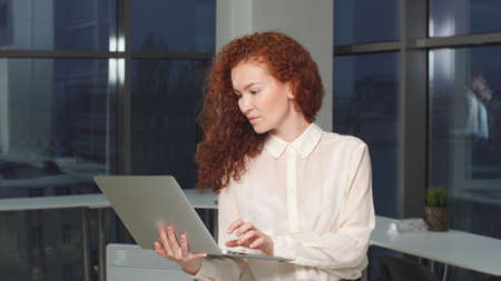 Portrait of modern woman freelancer with laptop in hands.
