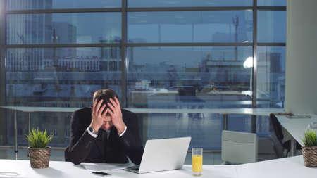 Serious man under stress at work.