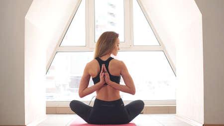 Attractive Woman Doing Yoga Meditation at Home Фото со стока