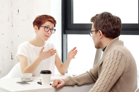 Business meeting in office. Job interview: female executive is meeting candidate and talking