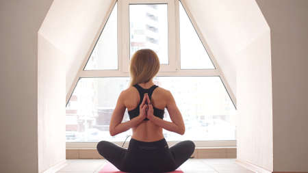 Young Female Meditate in Her Living Room