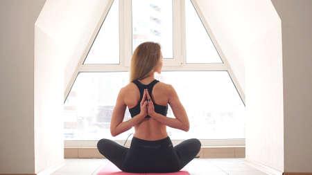 Young Beautiful Woman Meditate at Home on Mat Фото со стока