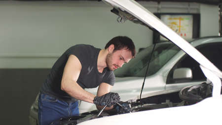 Auto mechanic service inspects current flow automobile and technical condition auto, diagnostics motor vehicle systems.