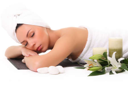 lying on back: Girl relaxing in spa Stock Photo