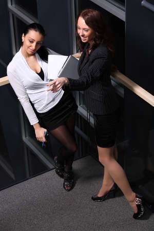 Portrait of Businesswomen pointing in the direction of photo