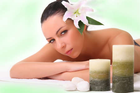 portrait of young beautiful woman in spa photo