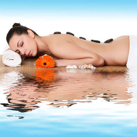 thalasso: Beautiful woman with hot stones on her back
