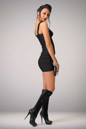 beautiful sexy woman in tight black dress 스톡 콘텐츠