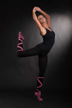 flexible girl on a black background photo