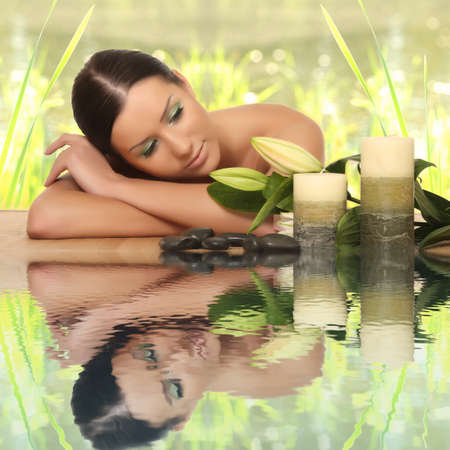 woman relaxing in spa, with reflection on the water Stock Photo