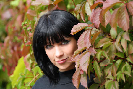 girl in the leaves of wild grapes. portrait photo