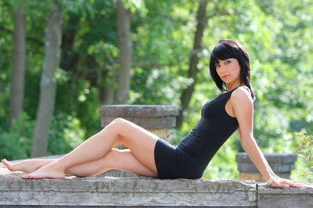Outdoor woman in a black dress.  photo