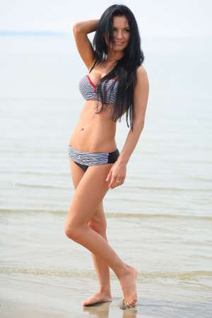 erotic girl on the beach photo
