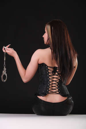 woman in latex with handcuffs photo