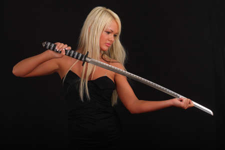 a woman with a large blade photo