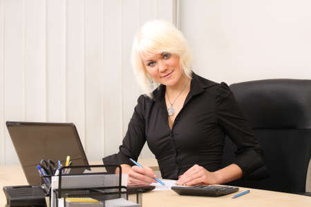 outwork: Business woman working in office Stock Photo