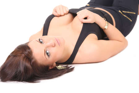Busty woman lies on a white background, isolated photo