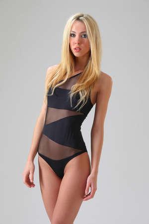 slim beauty in a black bikini photo