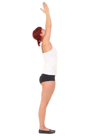 Young woman training yoga sun salutation , mountain pose Imagens